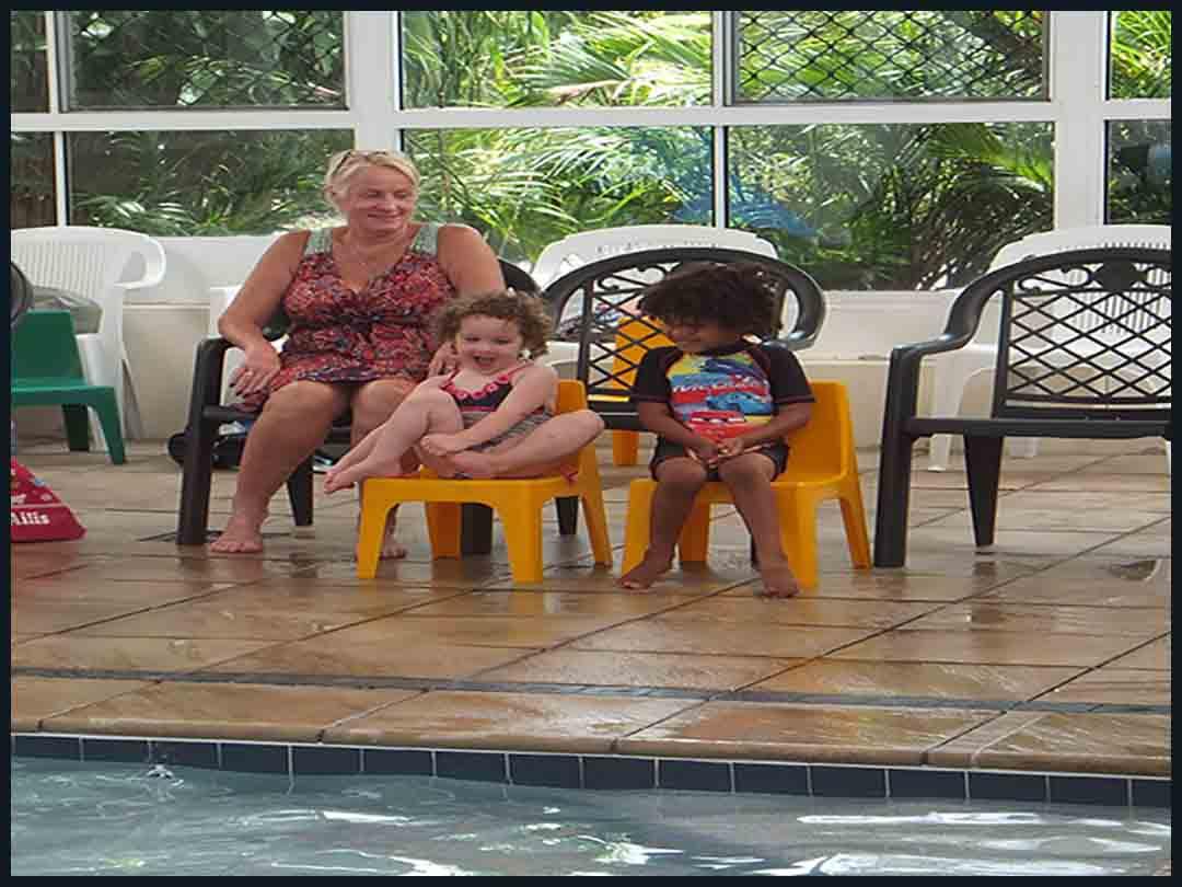 judy waiting with grandchildren